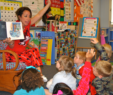 PreK Kindergarten Center principal Bonnie Jones reads to students.