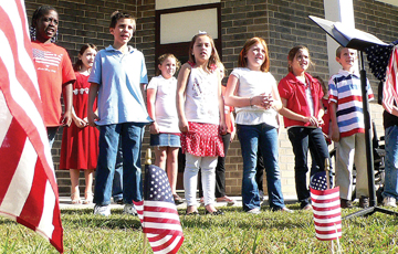 Westside first graders sing patriotic tunes during one of two programs that day to honor veterans.