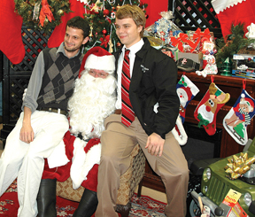 School band directors Mike Warren, left, and Matthew Jernigan with Vinnie Ferreira as Santa.