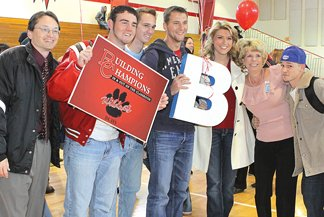 From left: BCHS principal Tom Hill, Tyler Mobley, Jonny Lambright, Dillon Jones, Jena Sands, Superintendent Sherrie Raulerson and Robert Raulerson in the BCHS gym after the school's new grade was announced.
