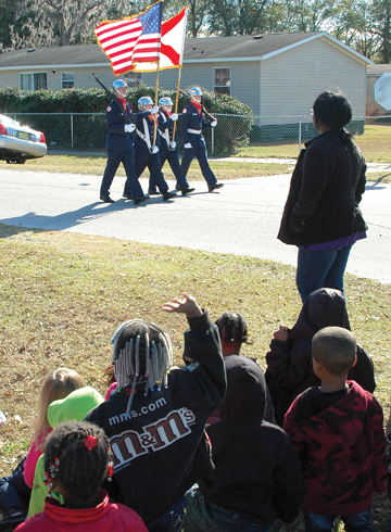 Preschool students watch AFJROTC color guard, which led the parade.