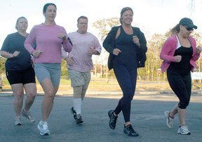 From left: Christa Figgins, Connie Walker, Michael Figgins, Debbie Foran and Sarah Green take the  first steps of a 5-miles run on a recent Saturday morning.