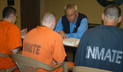 Instructor Gary Taylor meets with GED students at county jail.