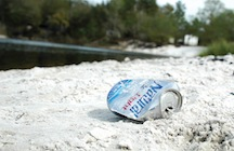 Beer can on the beach at Steel Bridge Road boat ramp.