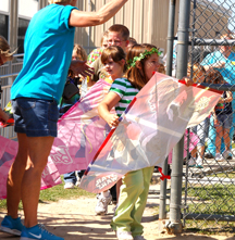 A group after first graders take the field for kite day.