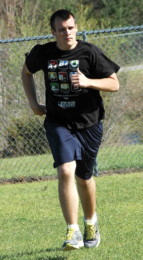 Kyle McCarty jogs after school March 4.