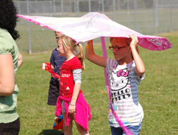 Third grader Vanessa Yale, 11, leaves the field on kite day.