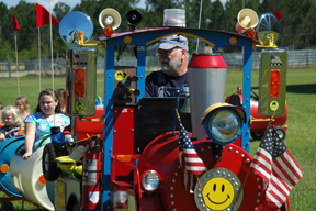 David Little of Little Barrels of Fun gave eager children rides on his train around the fairgrounds.