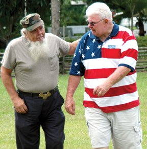 Above, Robert Osborn (left) of Jacksonville and Karl Joyce of Macclenny meet in a tearful reunion. Both attended Robert E. Lee High in Riverside.