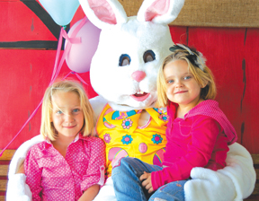 Reanna (left) and Journey Green with the Easter Bunny.