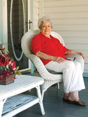 Mabel Grazil on the porch of her historic College Street home.