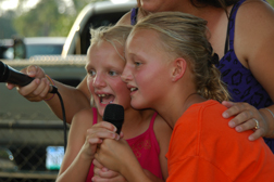 Faith (left) and Vanessa Yale sing with their mother Marlayna Yale during karaoke.