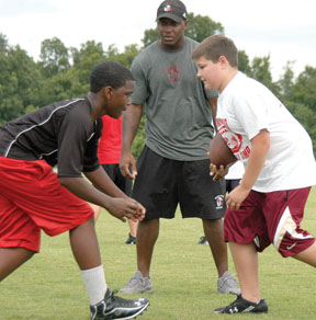 Kelly Williams runs a drill with junior campers.