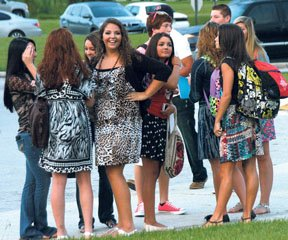 Students gather at the high school campus before the first day of school.