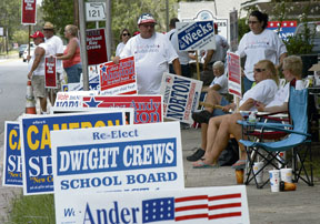 Candidates' supporters line N. 6th St. last weekend during early voting.