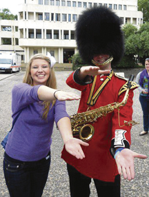 Ms. Hartley with a guard at Wellington Barracks.