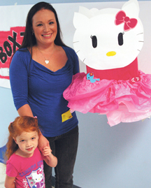 Sandy Rourke, winner of the box tops box decorating contest at the PreK Center where her daughter, Kayla (pictured), attends.