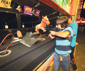 Noah Carter tests his aim at the fair.