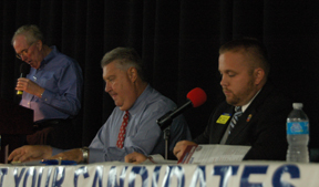 Sheriff candidates listen to a question from Press publisher and debate moderator Jim Mcgauley.