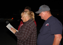 Chris Norton (center), Thomas Rhoden (right) and Theresa Rhoden tally vote results outside the elections office.