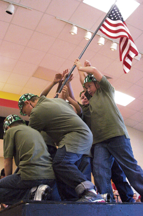 Students Noah Ray, Ian Doyle, Trey Dugger, Connor Altman, Colby Hapgood and Easton Stevens recreate the iconic image of US Marines planting a flag after the Battle of Iwo Jima.