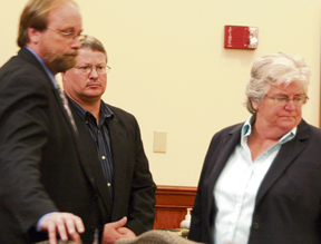 Defendent Marshall Mann (center) with his attorneys during his October trial.