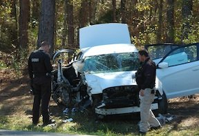 Madison County sheriff's deputies survey the suspect's crashed vehicle.