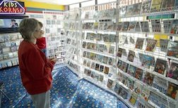 A customer peruses the discounted titles at Aardvark Video in Macclenny, which is liquidating its inventory ahead of closing its doors later this month.