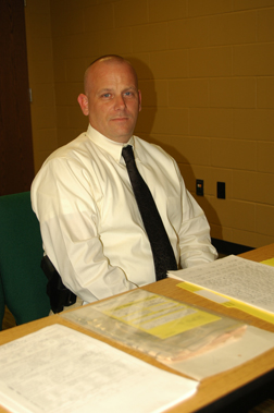 Lt. Brad Dougherty with cold case file on Arthur L. Green Jr.