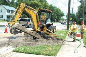 Macclenny utility workers repair a water main break on South 6th Street June 25.