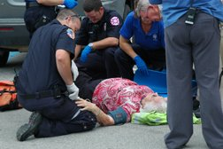 Waneta L. Bass is treated by EMS personnel in the Walmart parking lot.