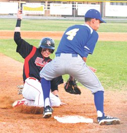 Hunter Hanks steals third base earlier this year.