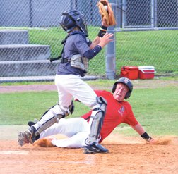 Jeremiah Iverson slides into home.