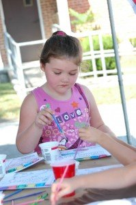 Baileigh Griffis, 5, of Macclenny painting during the event.