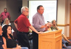 Dennis McClelland (right) and his attorney Hugh Fish speak about the mine's water supply.