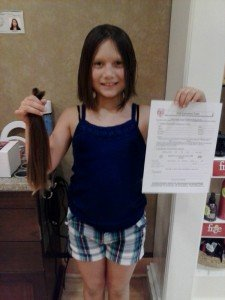 Hailey Hodgson with her hair donation. Photo courtesy of Rachel Hodgson.