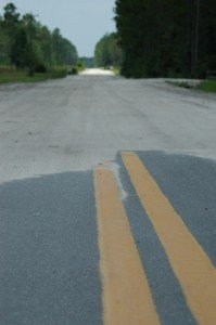 The gap in paving on Fred Harvey Rd. just west of Cow Pen Rd.