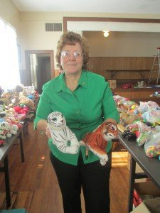WC's Marilyn Hodges shows off some of the toys for the annual Marjorie Lord Christmas Party