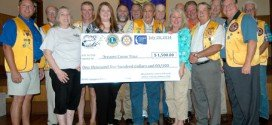 Lions present check from Possum event