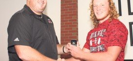 'Ringing' mementos presented to state weightlifting champs