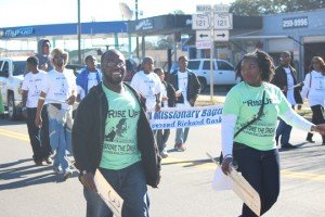 Charles W. Jackson and Kendra Jones walk in the morning MLK Day parade.