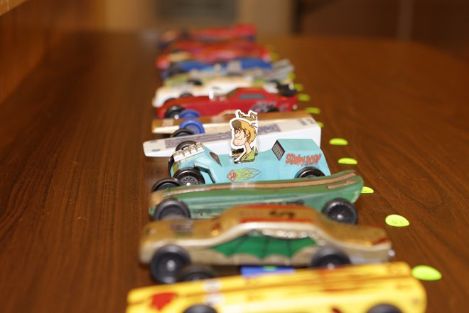 Some of the cars in the Pinewood Derby.