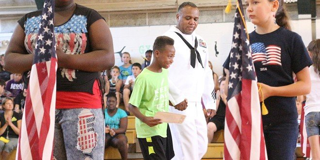 Keller holds a  tribute  to active  military  parent