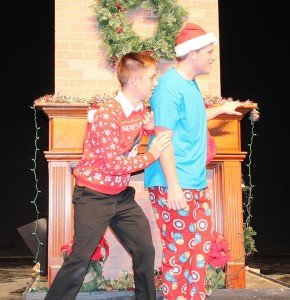Joel Griffis and Collin Crews sneaking up on Santa during Broadway in Baker Christmas.